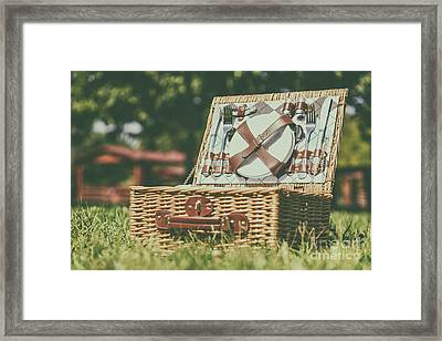 Opened Picnic Basket With Cutlery In Spring Green Grass Framed Print by Radu Bercan