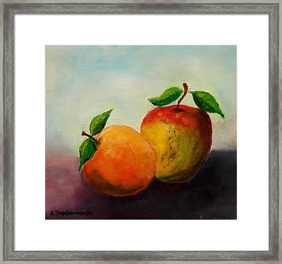 Apple And Orange Framed Print