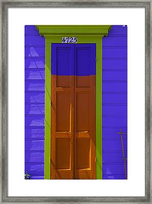 Orange And Blue Door Framed Print