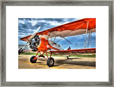 Orange Bi-plane Framed Print by Dan Crosby