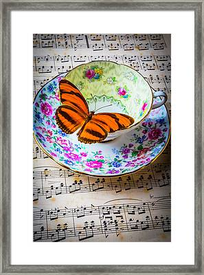 Orange Butterfly On Tea Cup Framed Print