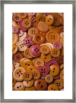 Orange Buttons Framed Print