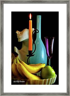 Orange Candle And Blue Bottle Framed Print