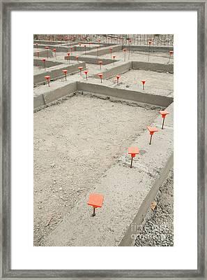 Orange Caps In Cement Foundation Framed Print