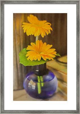 Orange Flowers Blue Vase Framed Print