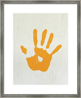 Orange Handprint On A Wall Framed Print