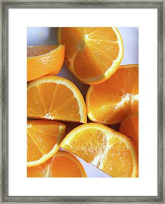 Orange Segments Framed Print by Tom Gowanlock