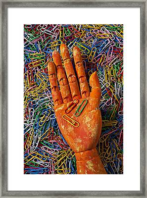Orange Wooden Hand Holding Paperclips Framed Print by Garry Gay