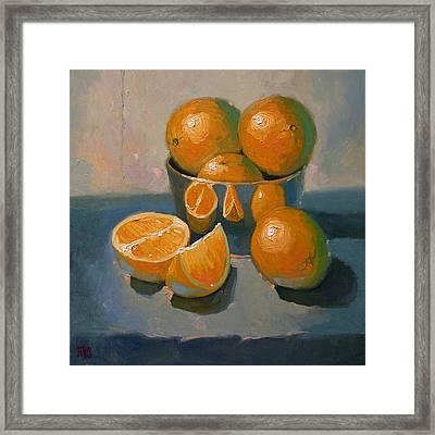 Oranges On A Blue Cloth Framed Print by Robert Lewis