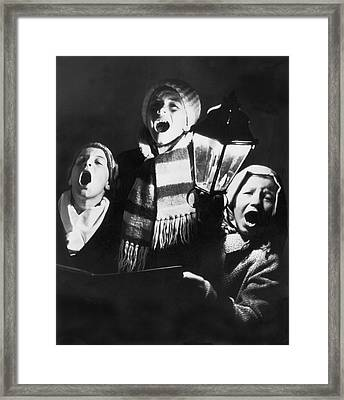 Orphans Sing Christmas Carols Framed Print by Underwood Archives