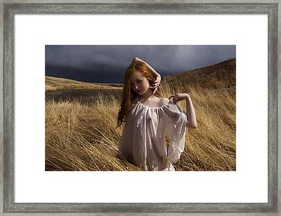 Out Of The Grass Framed Print