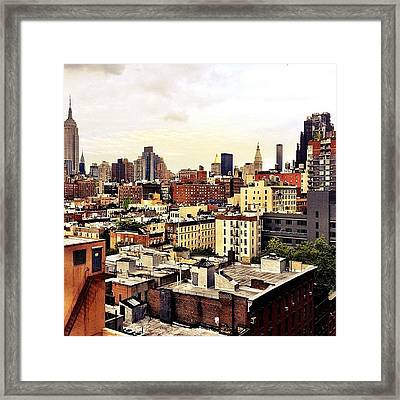 Over The Rooftops Of New York City Framed Print