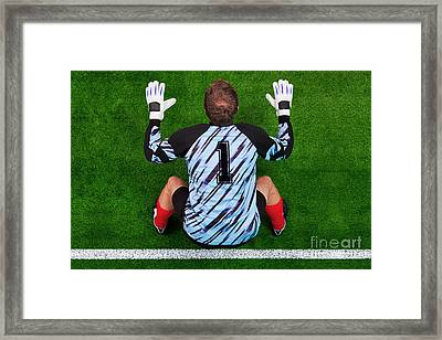 Overhead Shot Of A Goalkeeper On The Goal Line Framed Print