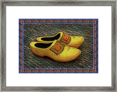 Framed Print featuring the photograph Oversized Dutch Clogs by Hanny Heim