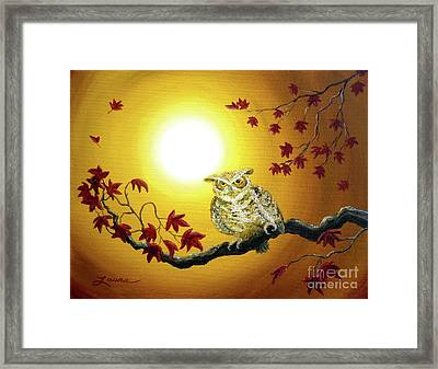 Owl In Autumn Glow Framed Print by Laura Iverson