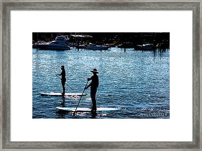 Paddle Boarding In The Marina Framed Print by Susan Vineyard