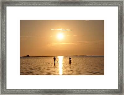 Paddle Boarding Out Of The Sunset Framed Print
