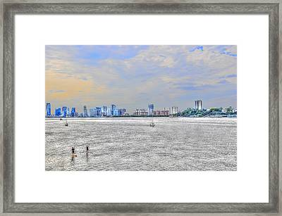 Paddleboarding At Dusk On The Hudson River Framed Print by Randy Aveille