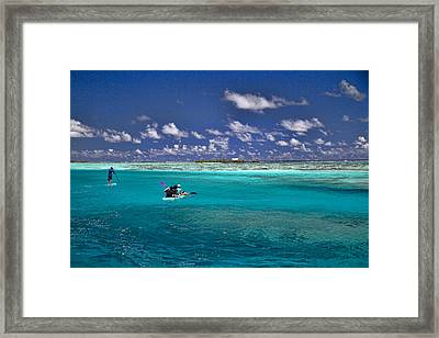 Paddling In Moorea Framed Print by David Smith