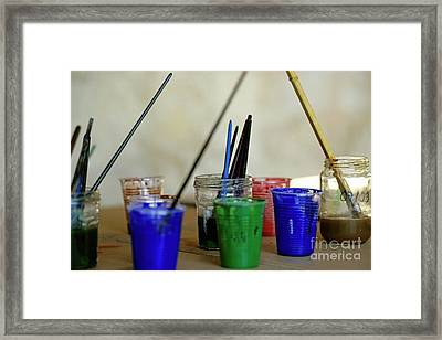 Paintbrushes Soaking In Water Framed Print by Sami Sarkis