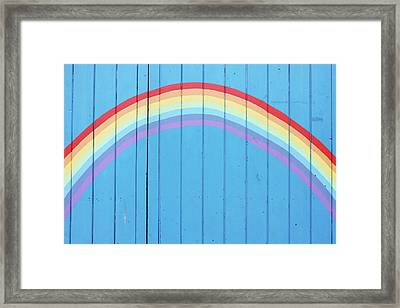 Painted Rainbow On Wooden Fence Framed Print by Richard Newstead