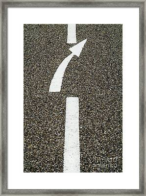 Painted White Arrow Sign In The Dividing Line On The Road Framed Print by Sami Sarkis