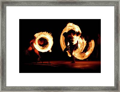 Pair Of Competing Fire Dancers Spinning Lit Batons At Night Afte Framed Print by Reimar Gaertner