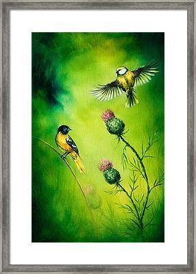 Pair Of Songbirds Flattering Above A Distel Flower, On An Emerald Green Background Framed Print by Jozef Klopacka