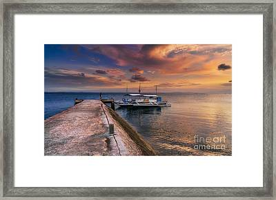Pandanon Island Sunset Framed Print by Adrian Evans