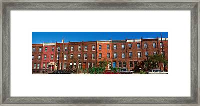 Panoramic Morning View Of Red Brick Row Framed Print by Panoramic Images