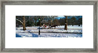 Panoramic View Of Snowy City Street Framed Print