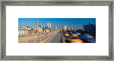 Panoramic View Of Speeding Taxis Framed Print by Panoramic Images