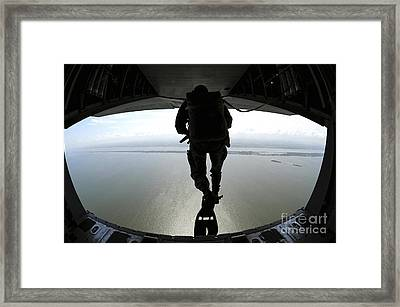 Pararescuemen Train On The Banana River Framed Print by Stocktrek Images