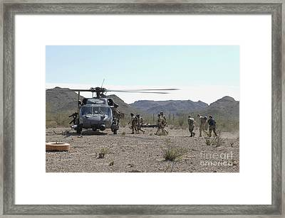 Pararescuemen Transport Rescuees To An Framed Print by Stocktrek Images