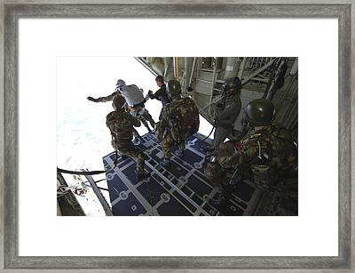 Paratroopers Jump From A C-130 Hercules Framed Print by Andrew Chittock