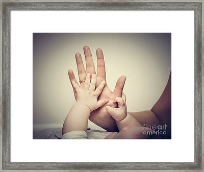 Parenthood. Mother And Her Little Baby Touching Each Other Hands Framed Print