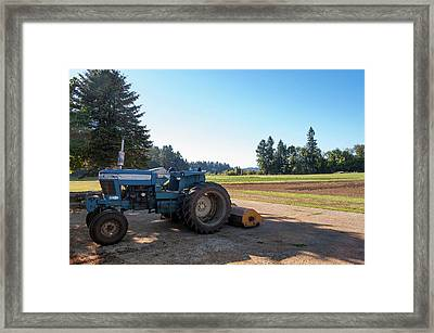 Parked Farm Tractor In Shade After Plowing Field Framed Print by Bradley Hebdon