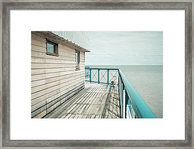 Part Of A Pier Framed Print by Tom Gowanlock