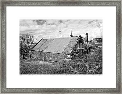 Partially Buried Red Tin Roofed Farm Outbuildings In Southern Iceland Framed Print