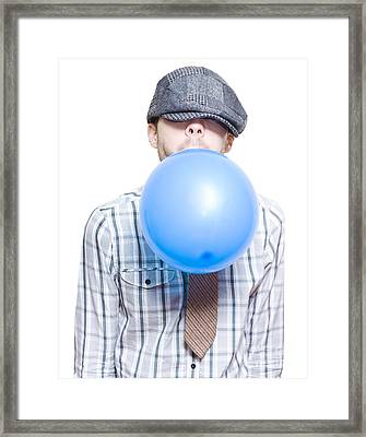 Party Boy Blowing Up New Years Eve Balloon Framed Print
