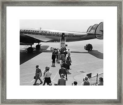 Passengers Boarding A Plane Framed Print by H. Armstrong Roberts/ClassicStock