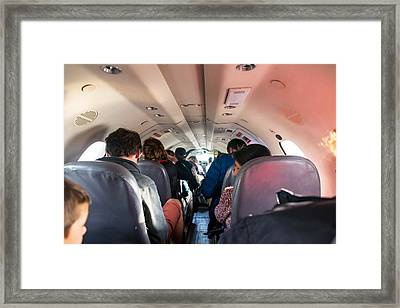 Passengers In Cramped Airplane Cabin Framed Print by Jess Kraft