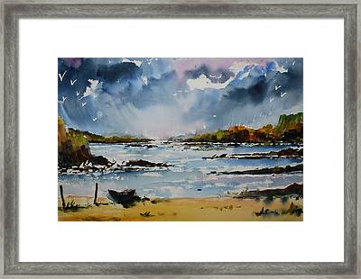 Passing Storm At Lahinch Framed Print by Wilfred McOstrich