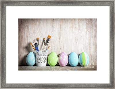 Pastel Easter Eggs And Brushes In A Rustic Cup Framed Print