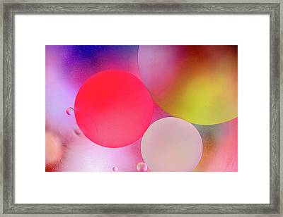 Framed Print featuring the photograph Pastel Oil Bubble Water Drops by John Williams