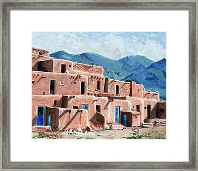 Patrolling The Pueblo Framed Print by Timithy L Gordon
