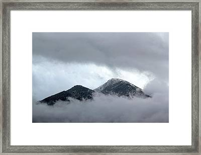 Peaking Through The Clouds Framed Print