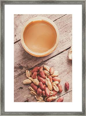 Peanut Butter Jar With Peanuts On Wooden Surface Framed Print