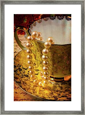 Pearls Hanging Off Tea Cup Framed Print