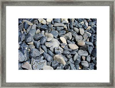 Pebbles Framed Print by Jacqueline Doulis